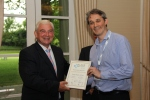 Colin Wilson of the GLA (right) receives the Park Royal Atlas certificate