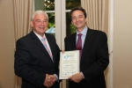 Duncan Bower of Westfield receives the White City certificate